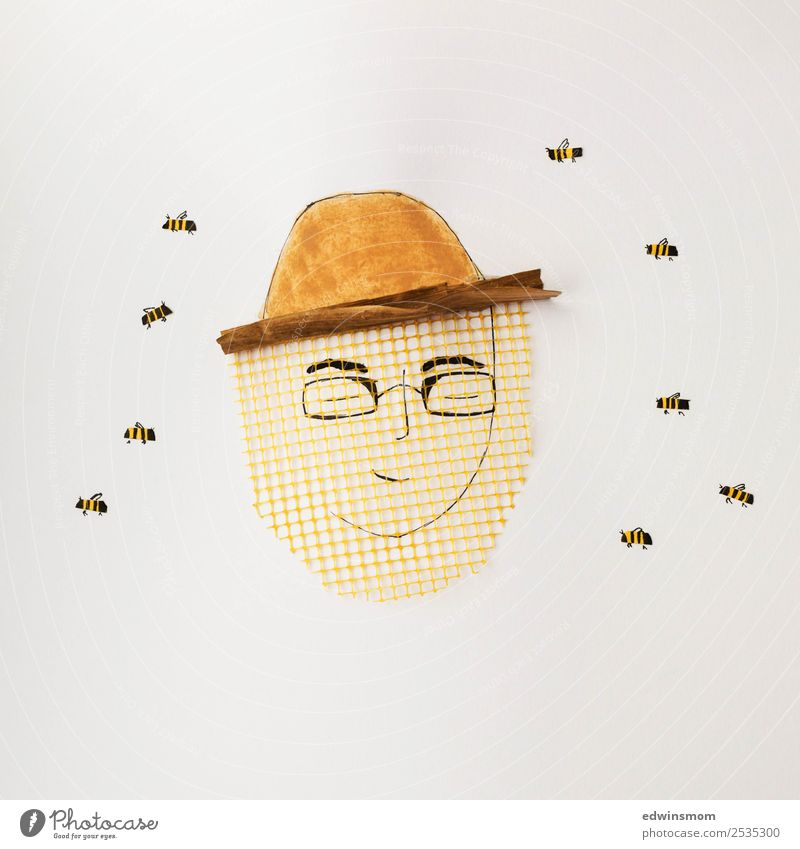 honeybee Leisure and hobbies Masculine Young man Youth (Young adults) 1 Human being Protective clothing Eyeglasses Hat Wild animal Bee Group of animals Paper