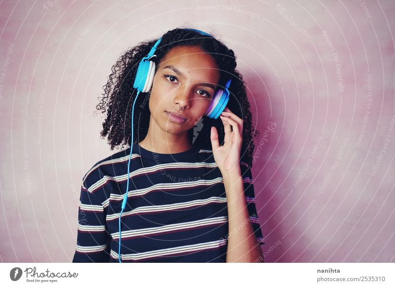 Teenage woman listening to music Lifestyle Style Beautiful Hair and hairstyles Leisure and hobbies Headset Headphones Technology Entertainment electronics
