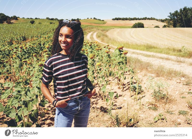 Young woman enjoying the day in a field of sunflowers Lifestyle Style Wellness Vacation & Travel Freedom Summer Summer vacation Human being Feminine