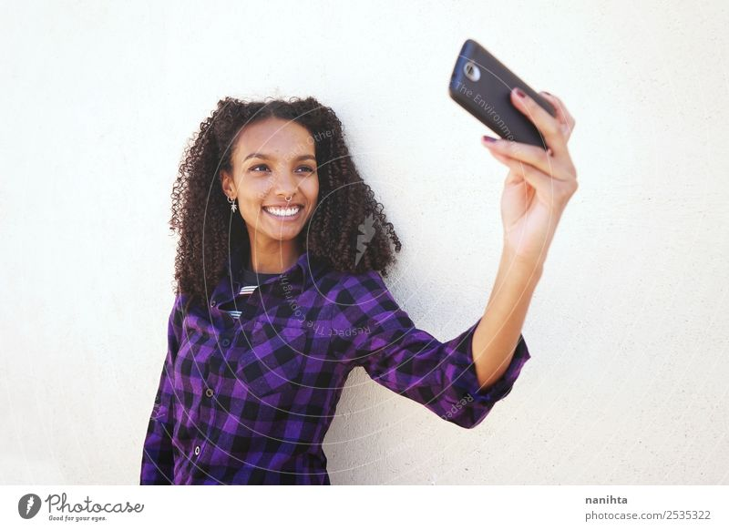 Young and happy woman taking a selfie Lifestyle Style Joy Hair and hairstyles Cellphone Camera PDA Technology Entertainment electronics Internet Human being