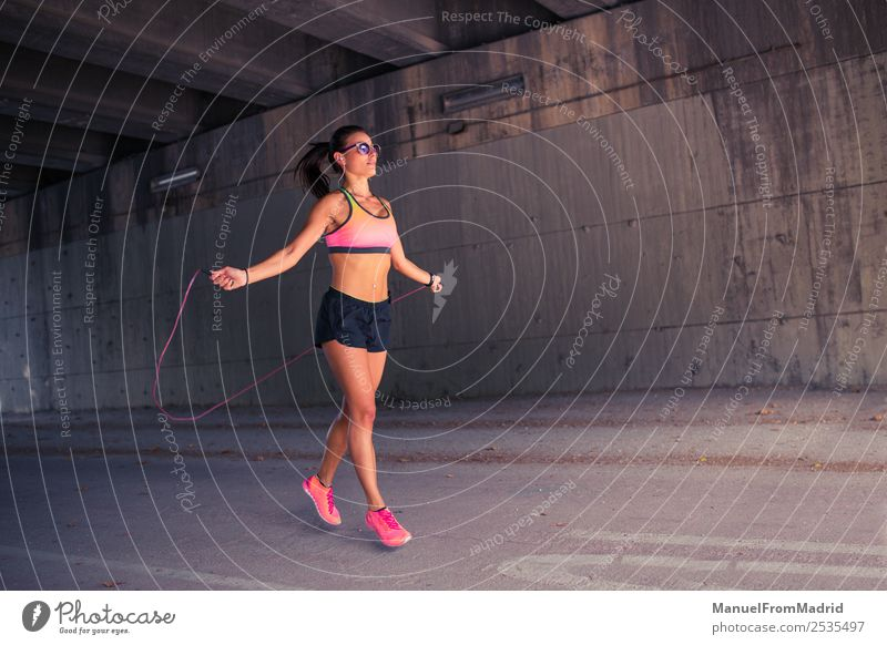 athletic woman jumping with skipping rope Lifestyle Happy Beautiful Body Wellness Sports Rope Woman Adults Movement Fitness Skipping Jump Thin Energy workout