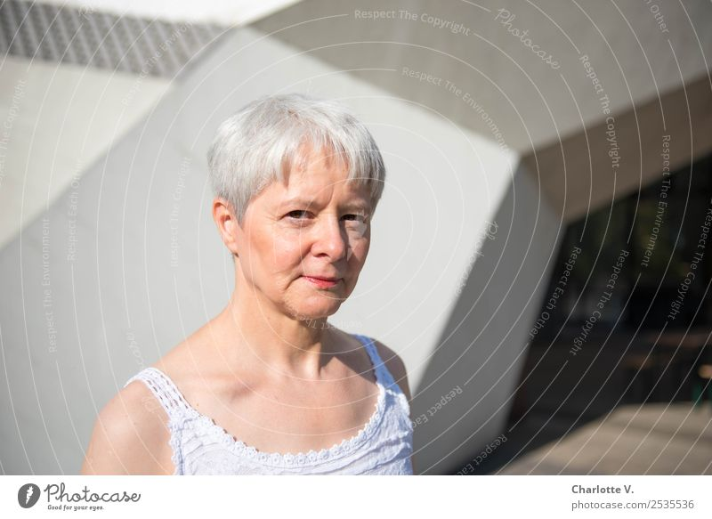Skeptical Human being Feminine Woman Adults Female senior 1 45 - 60 years Wall (barrier) Wall (building) Passage Gray-haired Short-haired Concrete Observe