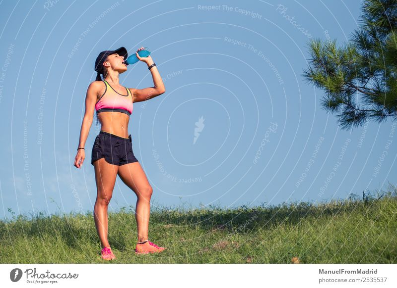 athletic woman resting and drinking Drinking Bottle Lifestyle Beautiful Summer Sports Woman Adults Nature Park Fitness Sit Energy workout Runner training