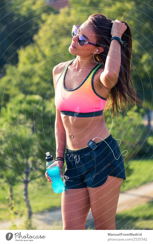 athletic woman portrait Drinking Bottle Lifestyle Beautiful Summer Sports Woman Adults Nature Park Fitness Sit Energy workout Runner training isotonic drink
