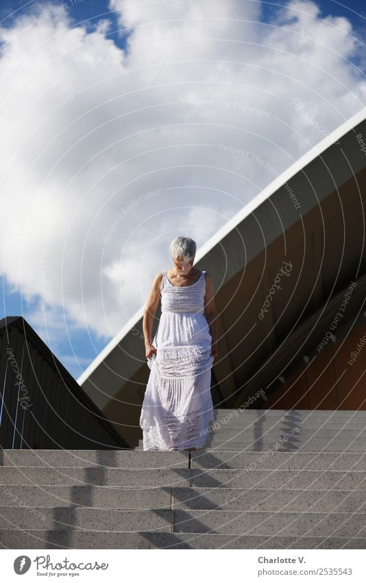 stride Human being Feminine Woman Adults Female senior 1 45 - 60 years Architecture Summer Manmade structures Stairs Facade Dress Gray-haired Short-haired