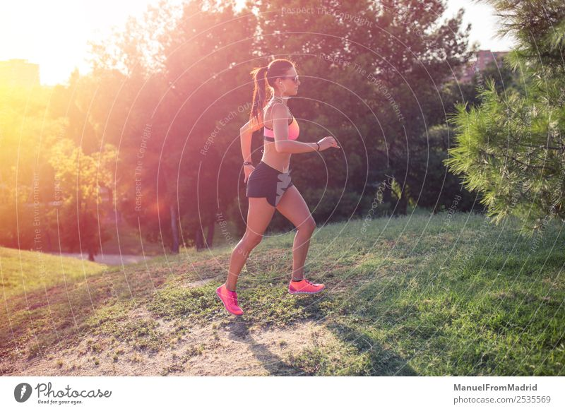 athletic woman running outdoors Lifestyle Beautiful Body Wellness Summer Sports Jogging Woman Adults Park Fitness Runner workout training Jogger healthy