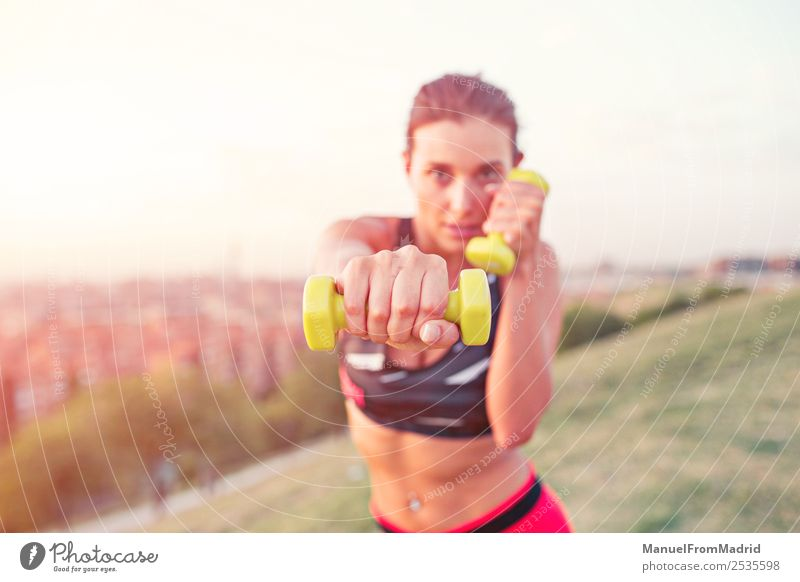 athletic woman working out outdoors Lifestyle Beautiful Sports Woman Adults Fitness using Dumbbell Punch young Practice training Action health power fit workout
