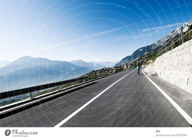 Summer Far-off places Street Mountain Movement Stone Wall (barrier) Leisure and hobbies Trip Speed Driving Alps Village Switzerland Fence Traffic infrastructure