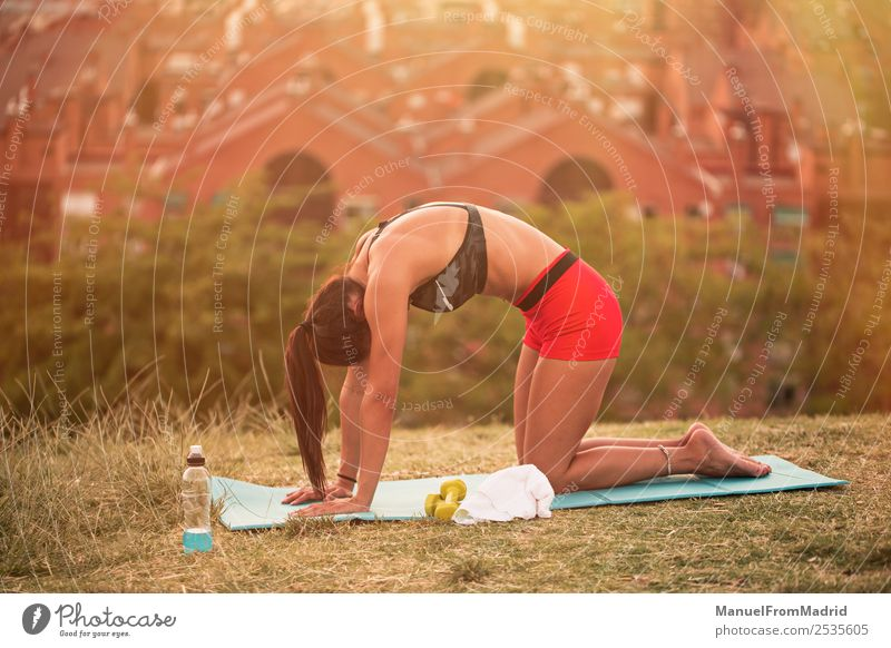 athletic woman working out outdoors Lifestyle Beautiful Health care Wellness Sports Woman Adults Park Fitness Athletic fit Mat stretching back Musculature