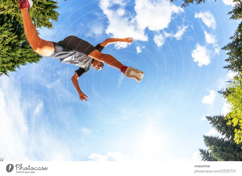 boy makes a jump in a mountain meadow. Lifestyle Joy Happy Relaxation Vacation & Travel Tourism Adventure Summer Sports Success Jogging Human being Boy (child)