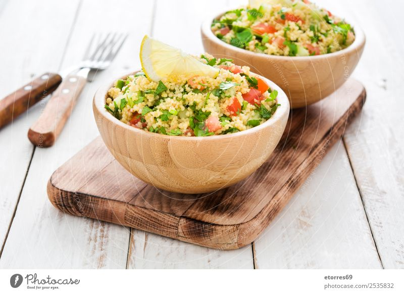 Tabbouleh salad in bowl Table Salad couscous Vegetable Tomato Cucumber Parsley Mint Vegan diet Vegetarian diet Healthy Eating Nutrition Diet Bowl Lemon Food