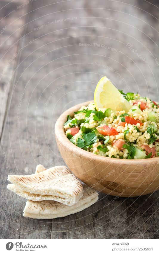 Tabbouleh salad and ingredients Table Salad couscous Vegetable Tomato Cucumber Parsley Mint Vegan diet Vegetarian diet Healthy Eating Nutrition Diet Bowl Lemon
