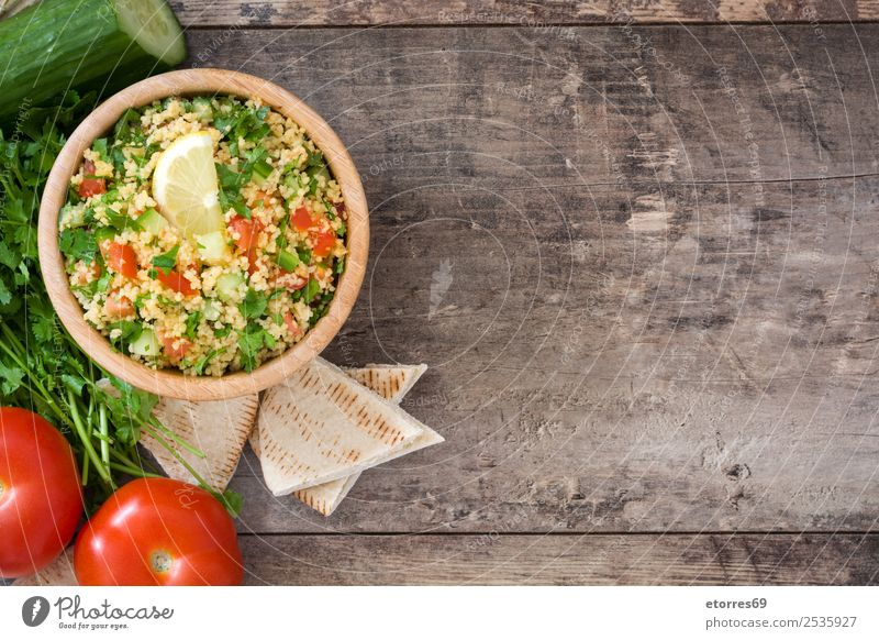 Tabbouleh salad Food Vegetable Nutrition Vegetarian diet Diet Bowl Healthy Healthy Eating Table Wood Red White Tradition Salad couscous Tomato Cucumber Parsley