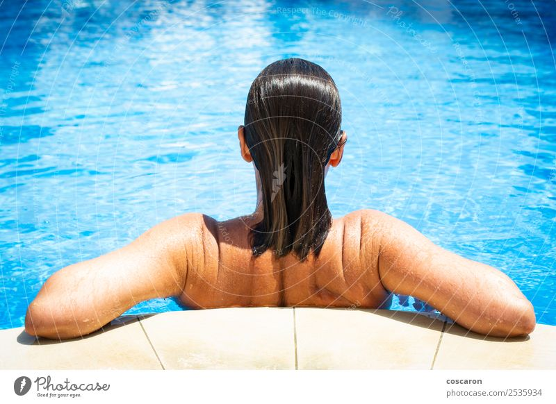 Woman from behind on the edge of a pool Human being Vacation & Travel Youth (Young adults) Old Young woman Summer Blue Beautiful Eroticism Relaxation Beach