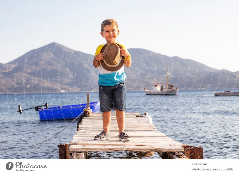 Portrait of a little kid on a dock with a hat in his hands Child Human being Sky Nature Vacation & Travel Man Summer Blue Beautiful White Ocean Relaxation Joy