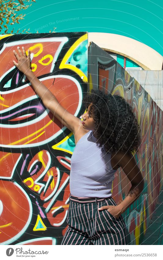 Portrait of urban woman with graffiti Lifestyle Exotic Joy Beautiful Feminine Young woman Youth (Young adults) Fashion Afro Graffiti Adventure Emotions Serene