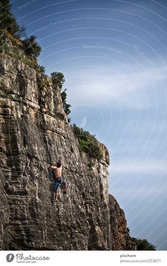 Climb Leisure and hobbies Sports Climbing Mountaineering Masculine Man Adults Sky Beautiful weather Rock Athletic Power Brave Passion Adventure Colour photo