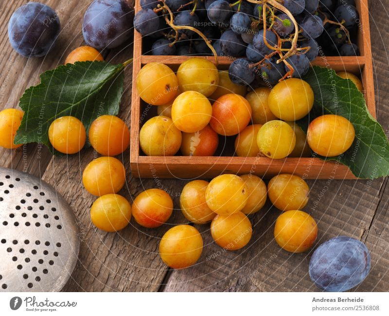 Mirabelle plums, plums and grapes Food Fruit Dessert Organic produce Vegetarian diet Diet Healthy Eating Summer Nature Delicious Yellow plum organic Planning