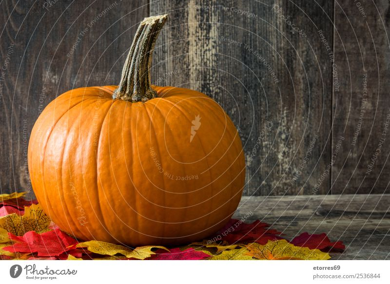 Pumpkin and autumn leaves on wooden background Autumn Food Healthy Eating Food photograph Orange Vegetable Hallowe'en Festive Seasons Holiday season October
