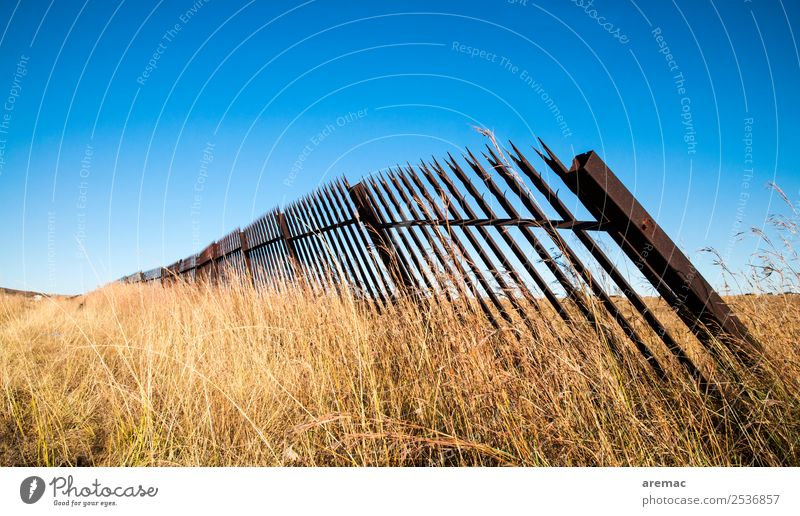 Old metal fence in the grass Nature Landscape Sky Cloudless sky Autumn Beautiful weather Grass Meadow South Africa Blue Yellow Emotions Grief damaged cemetry