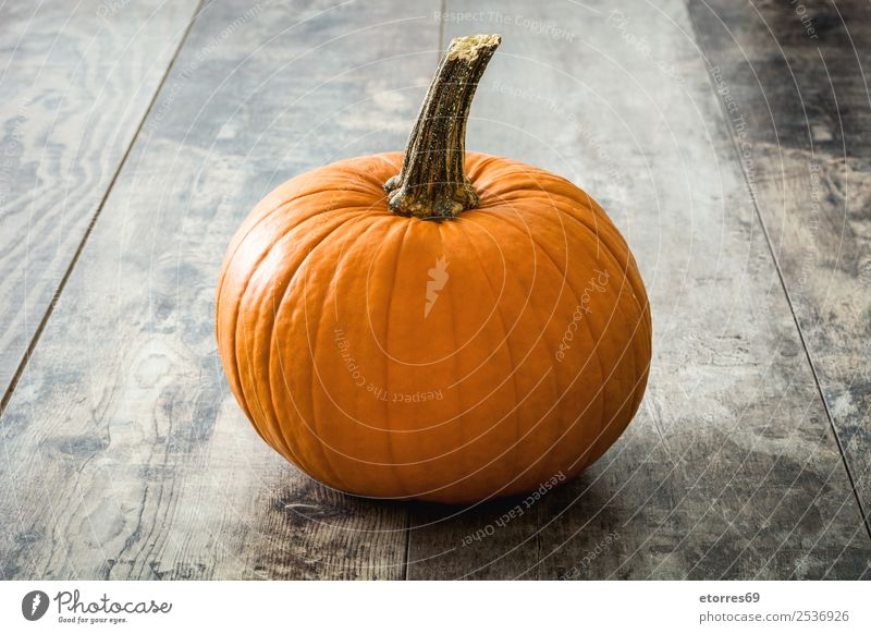 Pumpkin on rustic wood Food Healthy Eating Food photograph Orange Autumn Vegetable Hallowe'en Festive Seasons Holiday season October Dog food Wood Rustic