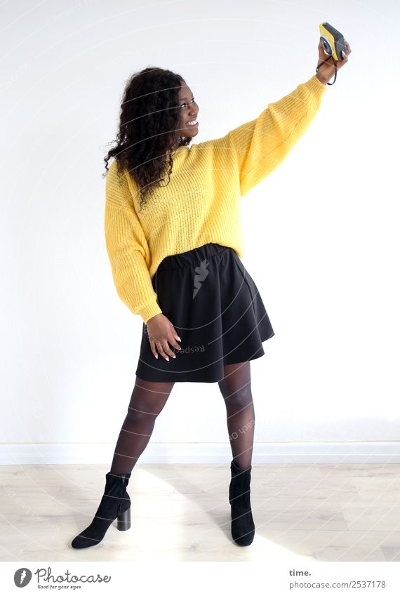 Apolline Room Feminine Woman Adults 1 Human being Media Camera Skirt Sweater Boots Brunette Long-haired Curl To hold on Laughter Looking Stand Happiness