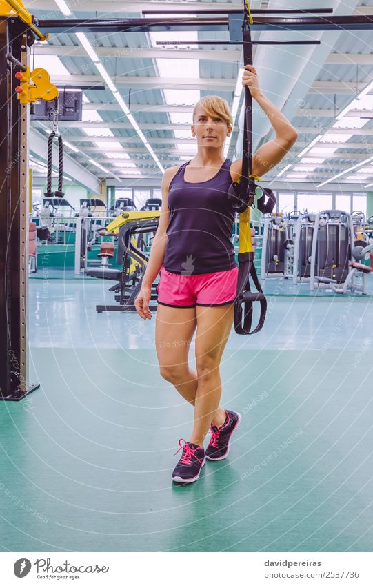 Woman standing out with a fitness straps Lifestyle Beautiful Body Club Disco Sports Rope Human being Adults Fitness Stand Authentic Muscular Strong trx training