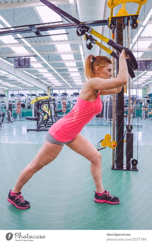 Woman doing suspension training with fitness straps Lifestyle Beautiful Body Club Disco Sports Rope Human being Adults Fitness Authentic Muscular Strong trx