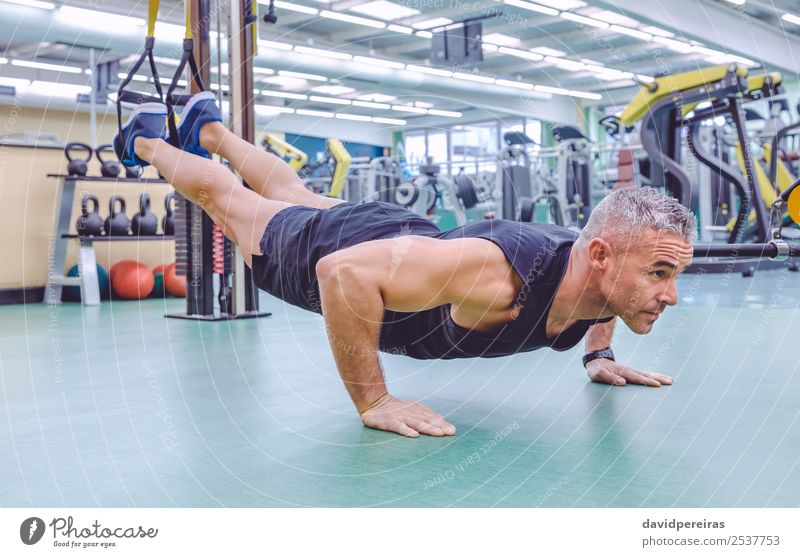 Man doing suspension training with fitness straps Lifestyle Beautiful Body Club Disco Sports Rope Human being Adults Fitness Authentic Muscular Strong trx