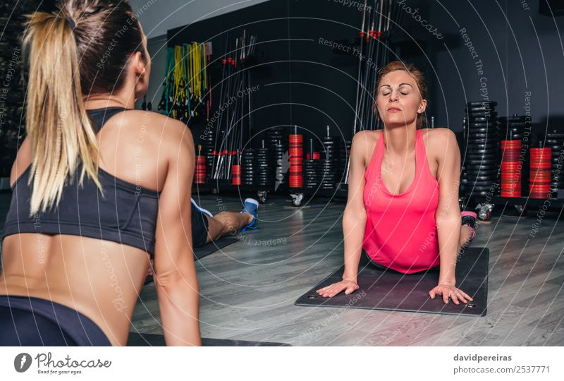 Woman stretching back in a fitness class Lifestyle Happy Beautiful Body Sports School Adults Arm Group Red-haired Braids Fitness Authentic Muscular people