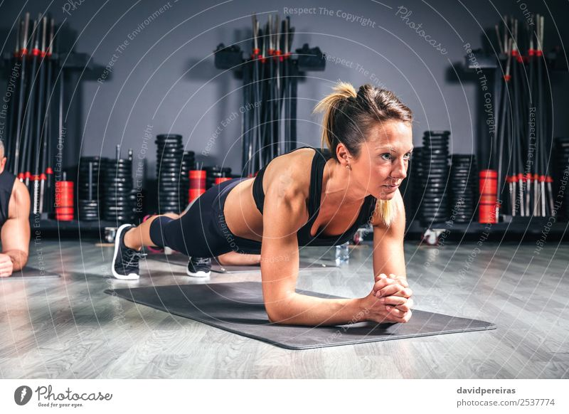 Woman doing push ups in fitness class Happy Body Sports School Adults Man Arm Group Fitness Authentic Muscular Strong pushup Core Practice Gymnasium Musculature