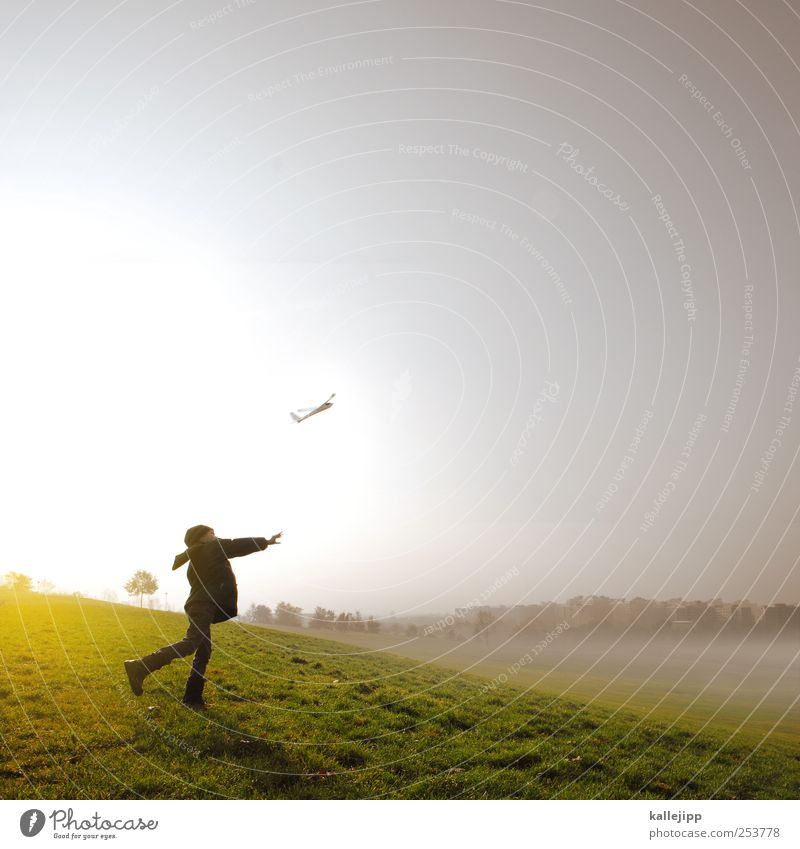 Human being Child Life Meadow Playing Boy (child) Dream Infancy Fog Success Aviation Travel photography Toys Airplane takeoff Easy