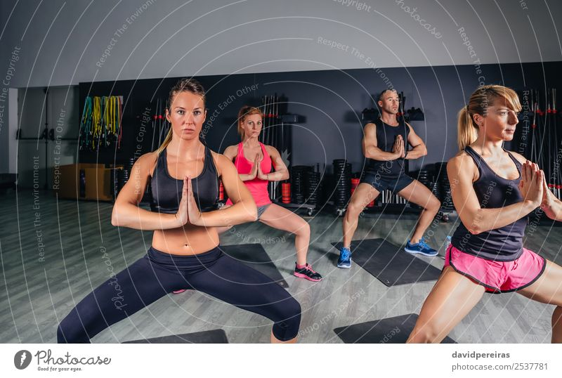 People doing stretch exercises in fitness class Lifestyle Happy Beautiful Body Club Disco Sports School Woman Adults Man Arm Hand Group Fitness Authentic