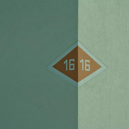 16 House (Residential Structure) Facade Brown Gray House number Arrow Wall (building) Wall (barrier) Plaster Rendered facade bright side Dark side Border Right