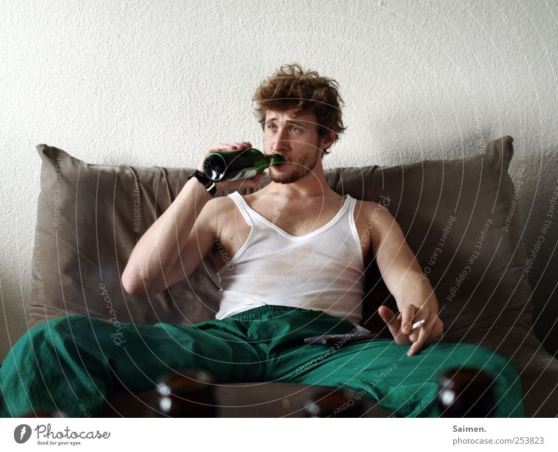 Human being Man Youth (Young adults) Adults Loneliness Masculine Clothing Drinking Smoking 18 - 30 years Beer Sofa Bottle Risk Cigarette Intoxicant
