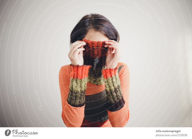 incognito. Feminine Woman Adults 1 Human being 18 - 30 years Youth (Young adults) Sweater Black-haired Inhibition Frustration Mysterious Shame Hide Orange