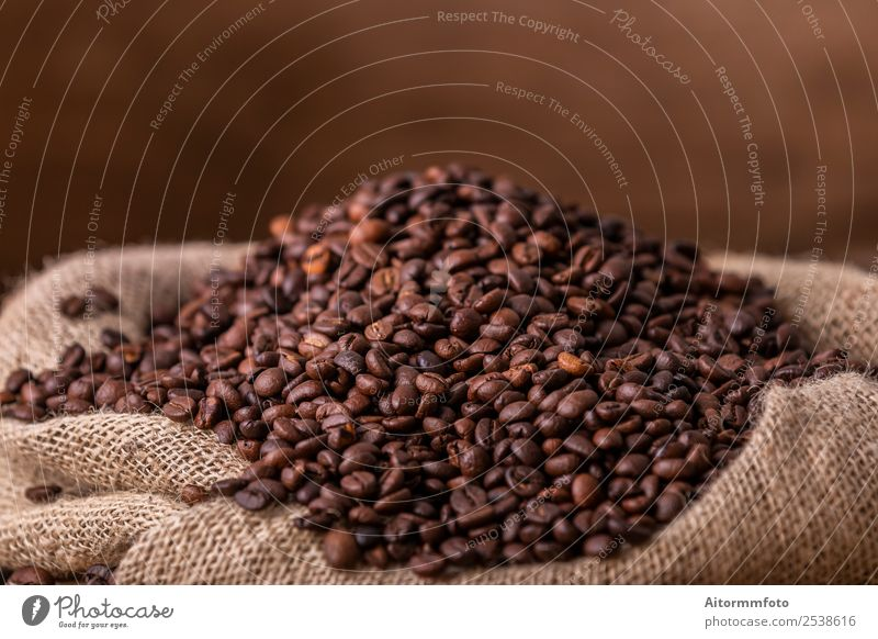 Sack of spilled roasted coffee beans Grain Breakfast Coffee Lifestyle Love Fresh Hot Delicious Natural Brown Energy Colour arabica Aromatic background bag
