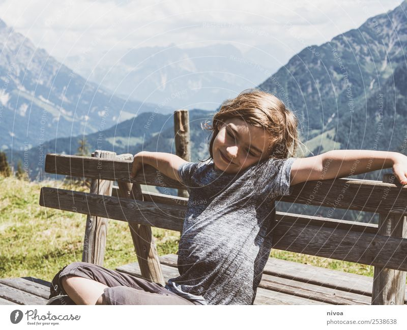 Boy sitting on bench in the background the mountains Vacation & Travel Trip Adventure Far-off places Freedom Summer Summer vacation Mountain Hiking Masculine
