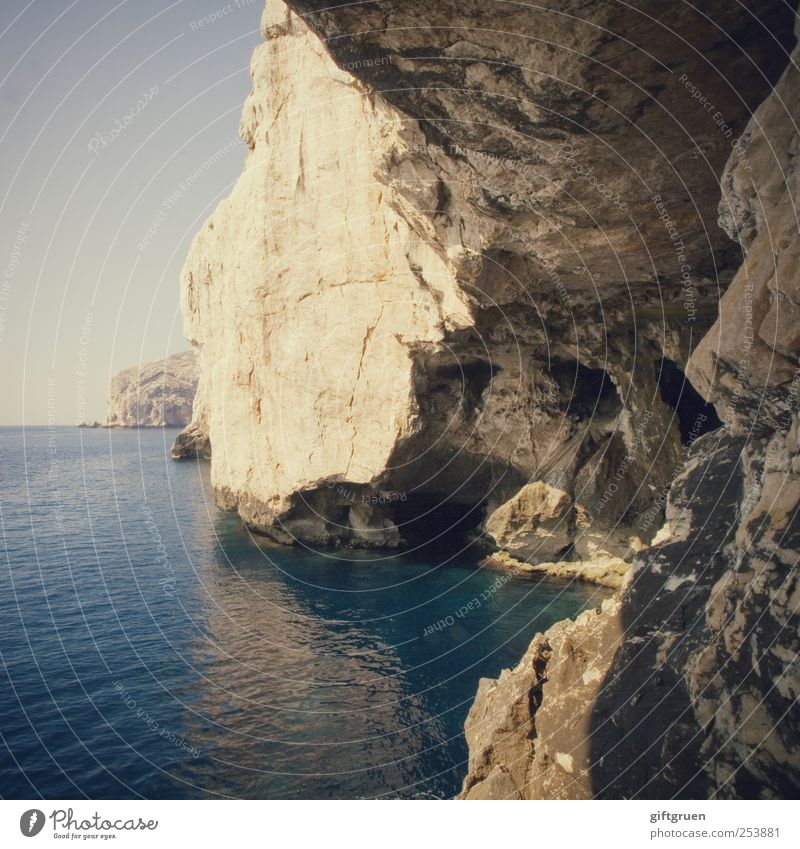 there is a crack in everything Environment Nature Landscape Elements Water Sky Cloudless sky Horizon Beautiful weather Rock Coast Ocean Island Esthetic Sardinia