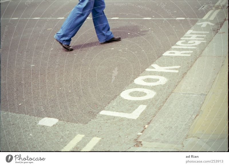 where the streets have a name. Human being Legs Feet 1 Populated Street Crossroads Road sign Going Colour photo Exterior shot Copy Space left Day Long shot