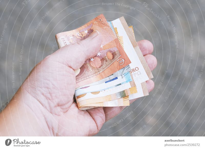 Hand holds Euro banknotes Lifestyle Shopping Luxury Business Human being Masculine Man Adults 1 To hold on Bank note Purchasing power Financial Industry bribe