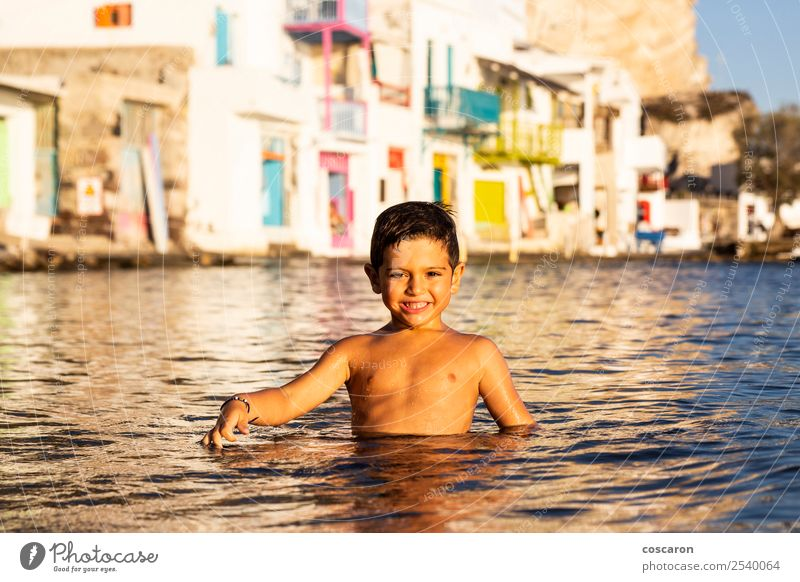 Little kid playing and swimming on the sea Child Human being Nature Vacation & Travel Summer Beautiful Green Ocean Joy Beach Lifestyle Natural Coast Happy