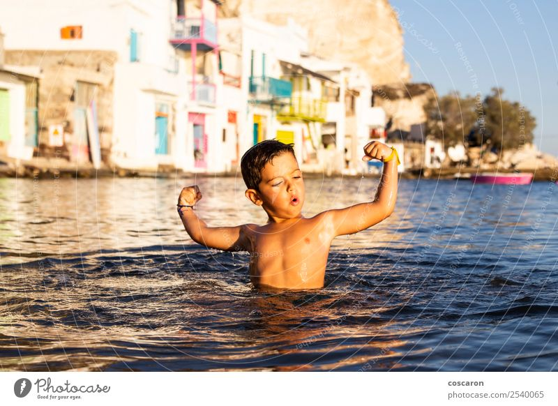 Little kid playing and swimming on the sea Lifestyle Joy Happy Beautiful Leisure and hobbies Playing Vacation & Travel Summer Beach Ocean Child Human being