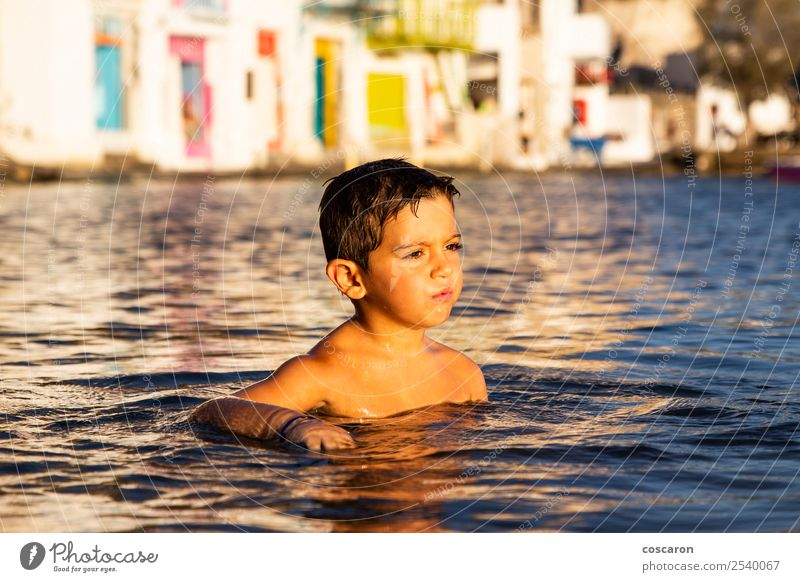 Little kid playing and swimming on the sea Child Human being Nature Vacation & Travel Summer Beautiful Green Ocean Relaxation Joy Beach Lifestyle Natural Coast