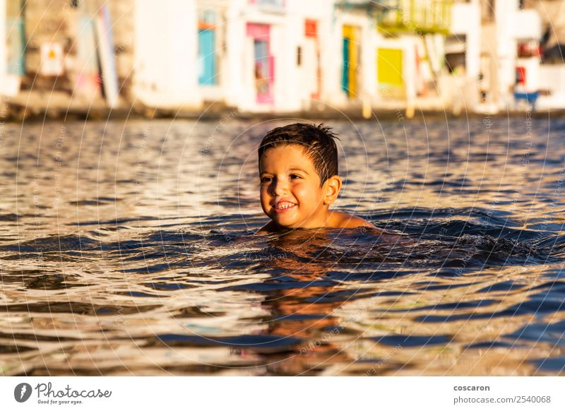 Little kid playing and swimming on the sea Child Human being Nature Vacation & Travel Summer Beautiful Green Ocean Joy Beach Lifestyle Natural Emotions Coast