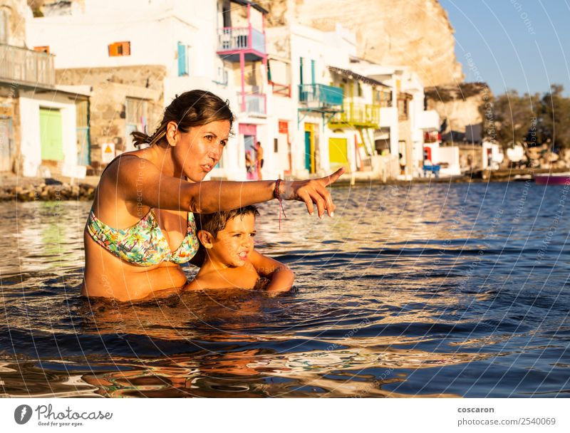 Mother and son playing on the beach inside the water at sunset Woman Child Human being Vacation & Travel Summer Beautiful Ocean House (Residential Structure)