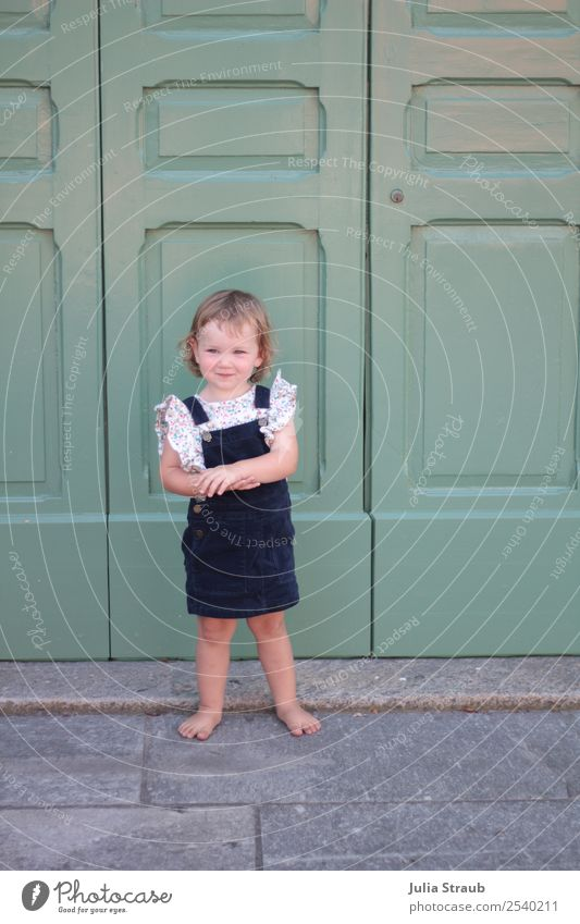 Girl small dress door Feminine 1 Human being 1 - 3 years Toddler Small Town Old town House (Residential Structure) Door Dress cord Blonde Curl Bangs Observe