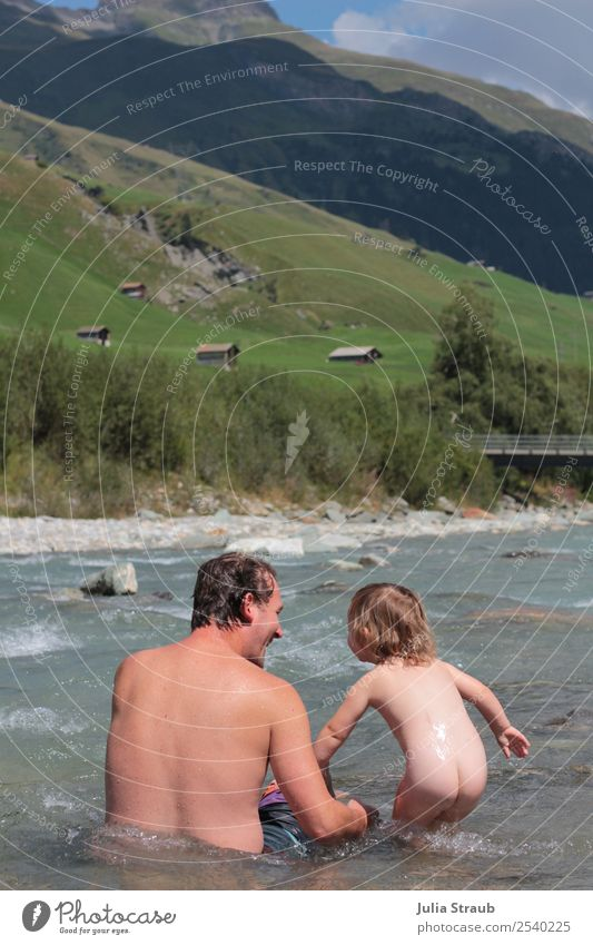 Baden river Switzerland mountains Toddler Girl Man Adults Father Family & Relations 2 Human being 1 - 3 years 30 - 45 years Sky Clouds Summer Beautiful weather