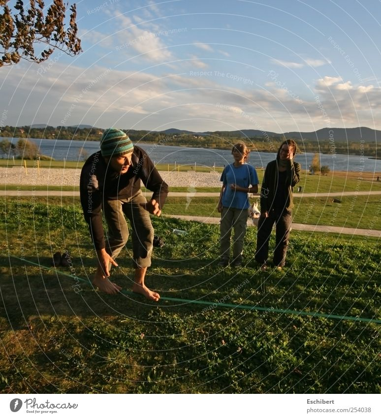Slackline at the lake Joy Playing Freedom Summer Sports Sportsperson Human being Masculine Young woman Youth (Young adults) Young man Friendship Life 3