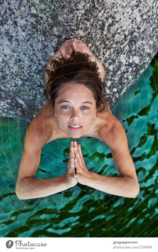 Young woman meditating. Joy Well-being Meditation Swimming & Bathing Yoga Feminine Youth (Young adults) Hand Fingers 1 Human being 18 - 30 years Adults